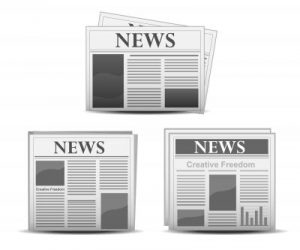 promote your real estate website in newspapers