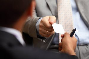 hand out your real estate business cards at every opportunity